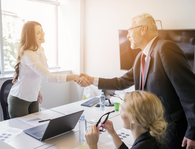 woman-shaking-hand-with-senior-businessman-after-finishing-the-meeting_23-2147923428